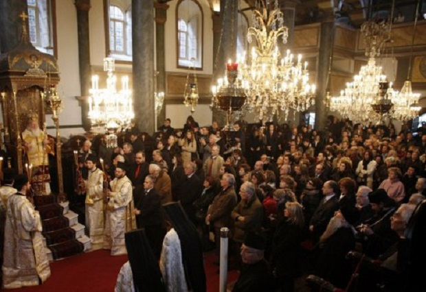 Greek Orthodox ecumenical Patriarch Bartholomew blesses believers during a Christmas mass in Aya Yorgi (St. George) church at Fener Greek orthodox patriarchate in Istanbul